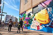 Street artists paint murals on the walls of the Bushwick neighborhood in Brooklyn, New York City, as part of the Bushwick Collective art movement.