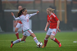 MERTHYR, WALES - Tuesday, February 14, 2017: Wales' Morgan Rogers in action against Hungary's Eszter Kovács during a Women's Under-17's International Friendly match at Penydarren Park. (Pic by Laura Malkin/Propaganda)
