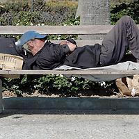 A homeless man fishes for change on Santa Monica Beach on Thursday, June 28, 2007.