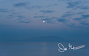 Full moon over Fernandina island, part of the Galapagos islands.