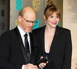 Photo Must Be Credited ©Alpha Press<br /> Bryce Dallas Howard and her father Ron Howard<br /> arrive at the EE British Academy Film Awards after party dinner at the Grosvenor House Hotel in London.