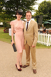 JONNY LEE MILLER and MICHELE HICKS at the third day of the 2010 Glorious Goodwood racing festival at Goodwood Racecourse, Chichester, West Sussex on 29th July 2010.