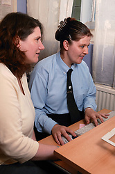 Woman with learning disabilities having a computer lesson,