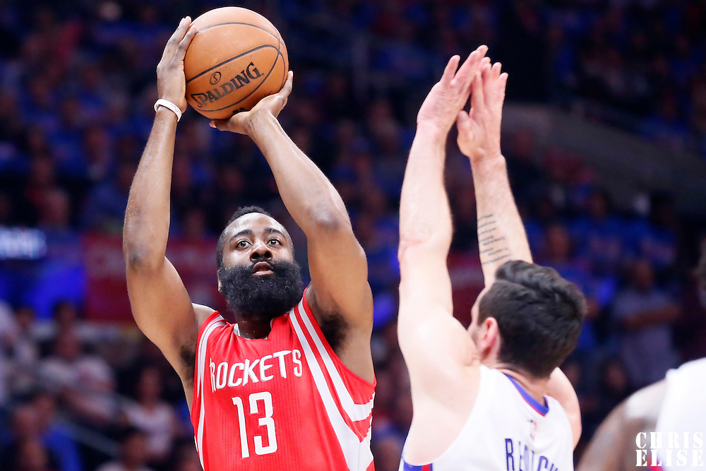 14 May 2015: Houston Rockets guard James Harden (13) takes a jump shot over Los Angeles Clippers guard J.J. Redick (4) during the Houston Rockets 119-107 victory over the Los Angeles Clippers, in game 6 of the Western Conference semifinals, at the Staples Center, Los Angeles, California, USA.