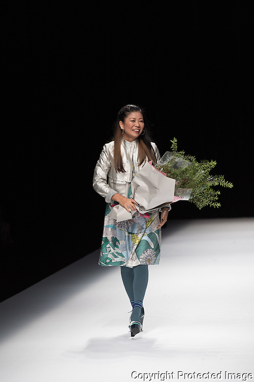 OCTOBER 21: Yuma Koshino at the end of her showcase at the Amazon Fashion Week Tokyo's 2017 Spring/Summer show under way at Shibuya Hikarie in Tokyo on Oct. 21, 2016. and other locations through 23rd. The designer Yuma Koshino is Graduating from Graduate Course of Bunka Fashion College, Yuma Koshino went to Paris and studied as a trainee at the atelier of Kenzo Takada. (91). After experiencing MICHIKO LONDON KOSHINO (92), HIROKO KOSHINO Design Office (97), she released YUMA KOSHINO collection in 1998. She tied up with HIROKO KOSHINO International Co.,Ltd. in 2006, and began to take full effect in her brand. She also produces uniform and black formal wear. She became a project professor at Bunka Gakuen University in 2015.Nearly 50 fashion brands and companies will hold their shows at several locations through 23rd.. 21/10/2016-Tokyo, JAPAN