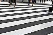 people walking on a zebra crossing Tokyo Japanpeople crossing at a zebra crossing Tokyo Japan