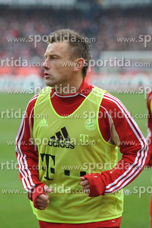 31.03.2012, Easy-Credit-Stadion, Nuernberg, GER, 1. FBL, 1. FC Nuernberg vs FC Bayern Muenchen, 28. Spieltag, im Bild Ivica Olic (Bayern Muenchen) laeuft sich warm. Im Hintergrund: Bastian Schweinsteiger (Bayern Muenchen). Freisteller // during the German Bundesliga Match, 28th Round between 1. FC Nuernberg and FC Bayern Munich at the Easy-Credit-Stadium, Nuernberg, Germany on 2012/03/31. EXPA Pictures © 2012, PhotoCredit: EXPA/ Eibner/ Matthias Merz..***** ATTENTION - OUT OF GER *****