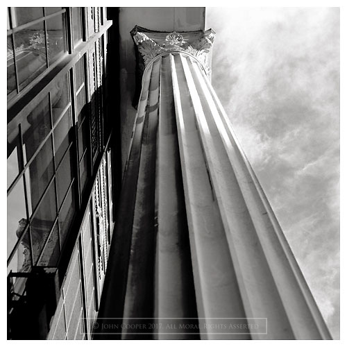 Black and white photograph of a Corinthian Column in Glasgow. Mounted print available to purchase.