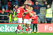 Bristol City midfielder Bobby Reid celebrates scoring the home teams second goal to give City a 2-1 lead during the Sky Bet Championship match between Bristol City and Derby County at Ashton Gate, Bristol, England on 19 April 2016. Photo by Graham Hunt.