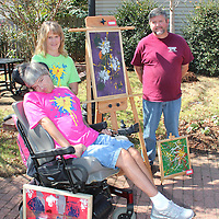 (Floyd Ingram / Buy at photos.chickasawjournal.com)<br /> Monica Herard loves to paint and was one of the artists with work on display at Art In The Park Thursday in downtown Houston. Shown with Herard are Laurie Craig of the T.K. Martin Center and Chickasaw County Extension Agent Scott Cagle.