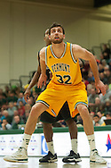 Catamounts forward Ethan O'Day (32) battles for position on a free throw attempt during the men's basketball game between the Binghamton Bearcats and the Vermont Catamounts at Patrick Gym on Monday night January 19, 2015 in Burlington, Vermont. (BRIAN JENKINS, for the Free Press)