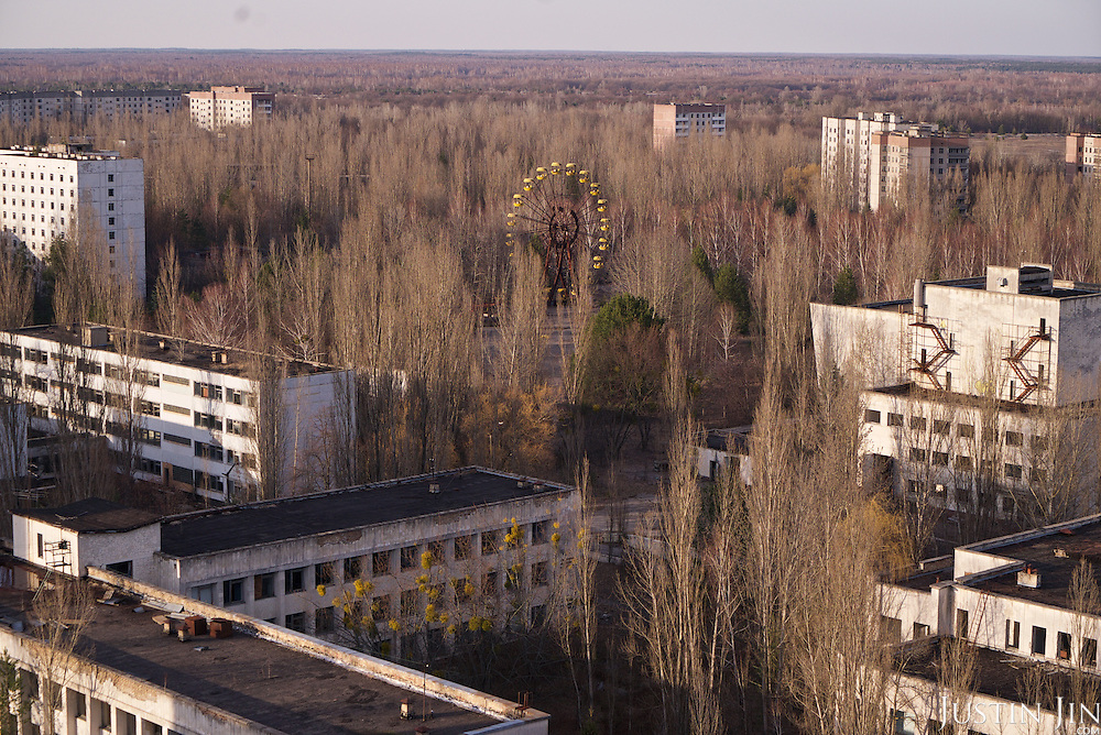 An unused ferris wheel in Pripyat, a ghost town left deserted by the nuclear disaster in the Chernobyl power station nearby. 30 years on, the city is still heavily contaminated, unfit for human life. <br /> <br /> The Chernobyl nuclear disaster happened on 26 April 1986. The ferris wheel was scheduled to be unveiled a few days after the disaster, but was never used.