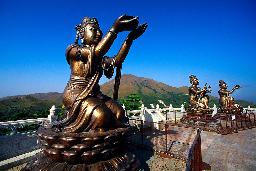 Six statues (Puja Bodhisattva) at foot of Tian Tan giant Buddha, Po Lin Monastery, Lantau Island, Hong Kong, China