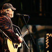 Robert Earl Keen performs to a packed crowd in Jackson, Wyoming. Portrait - Robert Earl Keen on stage.