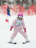 Lily Bishop catches a few raindrops on her tongue as she navigates the course during the Meister Cup with the Gunstock Ski Club on Wednesday afternoon.  (Karen Bobotas/for the Laconia Daily Sun)