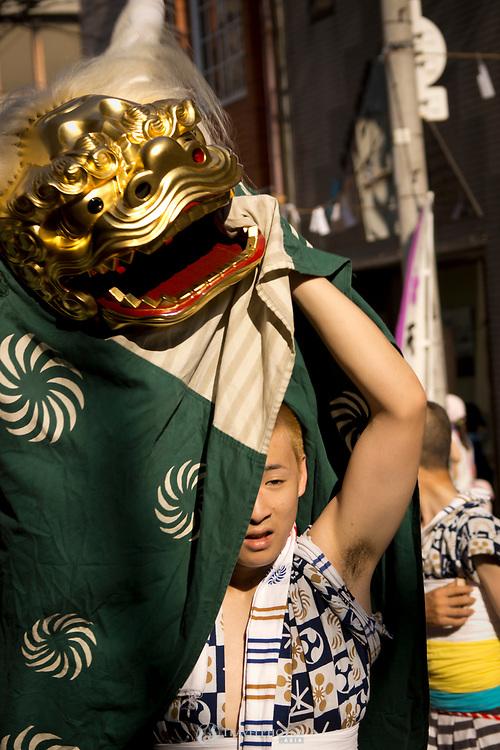 A young man doing at dragon dance in the Tenjin Festival (Tenjin Matsuri) in Osaka.