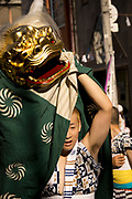 A young man doing at dragon dance in the Tenjin Festival (Tenjin Matsuri) in Osaka.