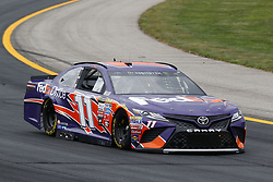 July 14, 2017 - Loudon, NH, United States of America - July 14, 2017 - Loudon, NH, USA: Denny Hamlin (11)  hangs out in the garage during practice for the Overton's 301 at New Hampshire Motor Speedway in Loudon, NH. (Credit Image: © Justin R. Noe Asp Inc/ASP via ZUMA Wire)