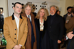 Left to right, TOM STURRIDGE, SIR TOM STOPPARD, LADY STOPPARD and SIR TOM JONES at the charity Child Bereavement UK's 21st Anniversary Christmas Carol Concert held at Holy Trinity Brompton, London on 10th December 2015.