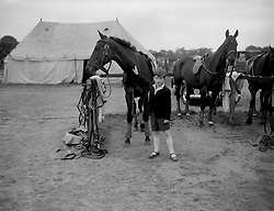 File photo dated 02/06/56 of Prince Charles giving a friendly pat to one of the ponies at Smith's Lawn, Windsor Great Park, where the Duke of Edinburgh was playing polo.