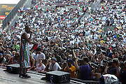 MOS DEF at The Rock the Bells International Festival Series powered by SandDisk held at Jones Beach on August 3, 2008..Few events can claim to both capture and define a movement, yet this is precisely what Rock The Bells has done since its inception in 2003. Rock The Bells is more than a music festival. It has become a genuine rite of passage for thousands of core, social, conscious, and independent Hip Hop enthusiasts, backpackers, and heads. Following in the colorful tradition and history of past Hip Hop music festivals such as Smoking Grooves and Cypress Hill?s Smoke Out, Rock The Bells is the ultimate Hip Hop platform and premiere music experience in America. Rock The Bells has established a forum of unparalleled diversity and excellence by uniting the biggest names involved with urban culture.