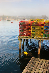 Lobster traps and boats in morning fog.  Corea, Maine.