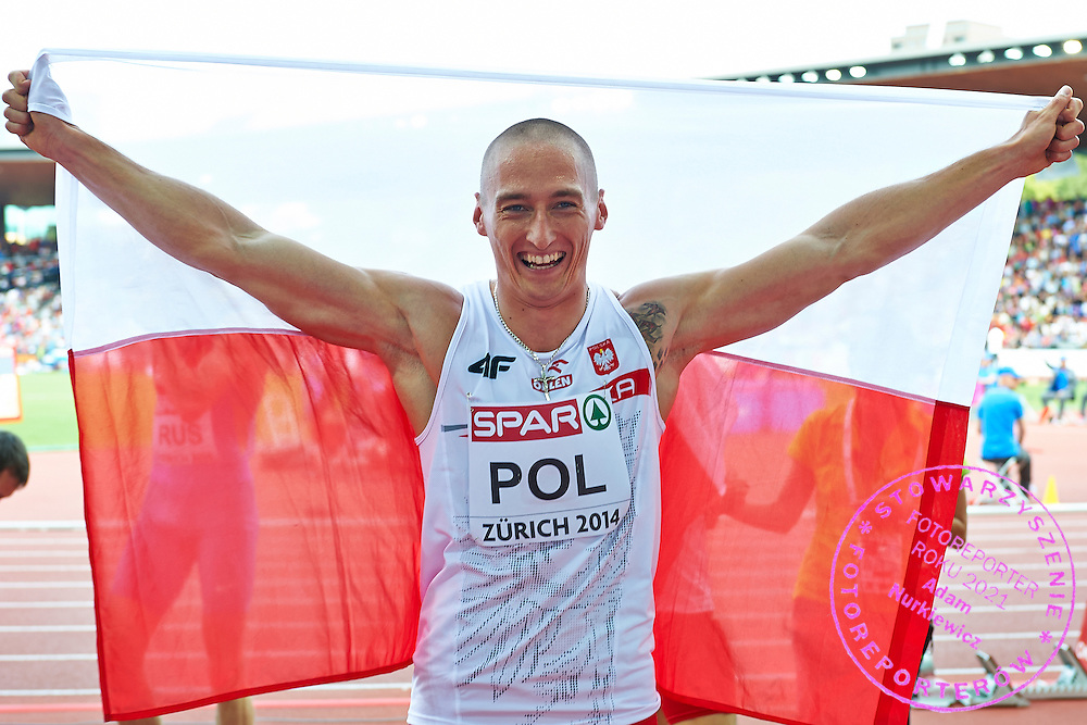 Jakub Krzewina from Poland poses with Polish flag after won bronze medals in Men's Relay 4 x 400 meters final during the Sixth Day of the European Athletics Championships Zurich 2014 at Letzigrund Stadium in Zurich, Switzerland.<br /> <br /> Switzerland, Zurich, August 17, 2014<br /> <br /> Picture also available in RAW (NEF) or TIFF format on special request.<br /> <br /> For editorial use only. Any commercial or promotional use requires permission.<br /> <br /> Photo by &copy; Adam Nurkiewicz / Mediasport