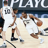 01 May 2017: San Antonio Spurs forward Kawhi Leonard (2) drives past Houston Rockets forward Trevor Ariza (1) on a screen set by San Antonio Spurs forward David Lee (10) during the Houston Rockets 126-99 victory over the San Antonio Spurs, in game 1 of the Western Conference Semi Finals, at the AT&T Center, San Antonio, Texas, USA.