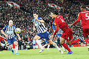 Liverpool defender Virgil van Dijk (4) and Brighton and Hove Albion defender Lewis Dunk (5) race to the ball during the Premier League match between Liverpool and Brighton and Hove Albion at Anfield, Liverpool, England on 30 November 2019.