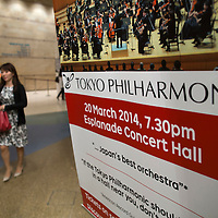 A Tokyo Philharmonic Orchestra poster is displayed next to the invitation desk before the reception cocktail of the Tokyo Philharmonic Orchestra during the 100th Anniversary concert at the Esplanade Hall on 20 March 2014 in Singapore. Photo by Jerome Favre / studioEAST