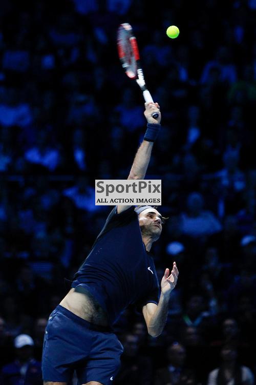 LONDON, ENGLAND - November 17:  Roger Federer serves in a match between Novak Djokovic and Roger Federer at the ATP World Tour Finals 2015 at the O2 Arena, London.   on November 17, 2015 in London, England. (Credit: SAM TODD | SportPix.org.uk)