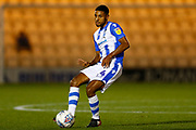 Colchester United midfielder Brandon Comley (14) plays a pass during the EFL Trophy match between Colchester United and Southend United at the Weston Homes Community Stadium, Colchester, England on 9 October 2018.