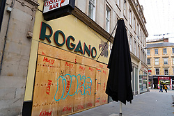Glasgow, Scotland, UK. 17 July, 2020.  Images from Glasgow city centre as covid-19 restrictions are relaxed and  the public are out and about shopping and at work. Pictured; Rogano Oyster Bar restaurant remains closed and boarded up.. Iain Masterton/Alamy Live News