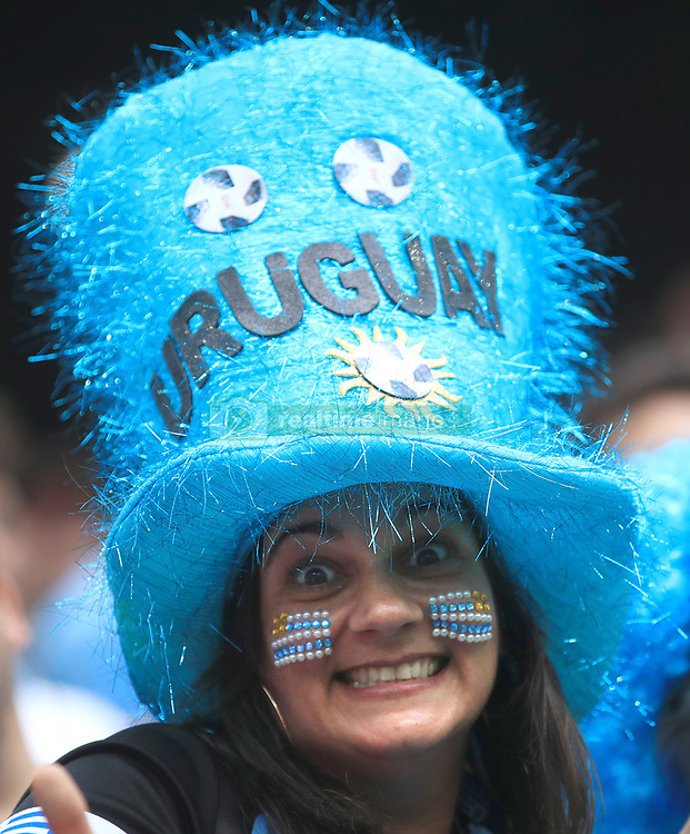 A Uruguay fan shows her support in the stands ahead of the match