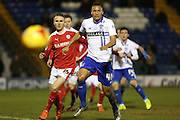 Reece Brown of Bury tries to get infrront of Marley Watkins of Barnsley during the Sky Bet League 1 match between Bury and Barnsley at The JD Stadium, Bury, England on 23 February 2016. Photo by Simon Brady.