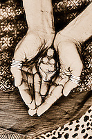 A woman's hands cradle an ancient goddess totem. Contemporary wise woman spirit. Sepia toned black and white photograph. Fine Art Photography
