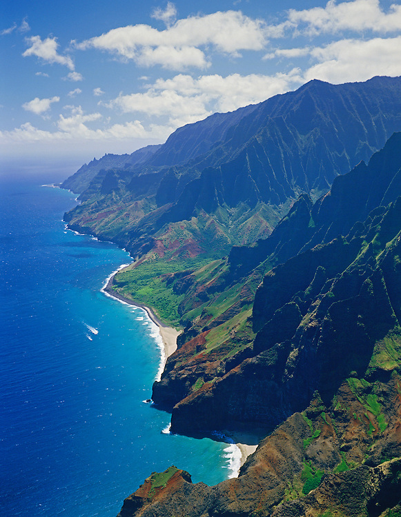 Na Pali Coast, Kauai, Hawaii: aerial view of beaches, pali (cliffs) and coastline from helicopter tour.
