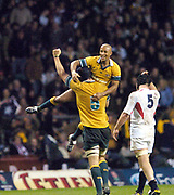 2004 England vs Australia - Investec Challenge - Twickenham..Daniel Vickerman lift's his skipper, George Gregan, in a victory salute at the final whistle as Australian clinch victory at Twickenham 19 -21. Steve Borthwick walk's past. ..27.11.2004 Photo  Peter Spurrier. .email images@intersport-images.com...