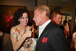 MOLLIE DENT-BROCKLEHURST and MICHAEL FLATLEY at a private view of paintings by Michael Flatley entitled Firedance held at 12 hay Hill, London on 24th June 2015.