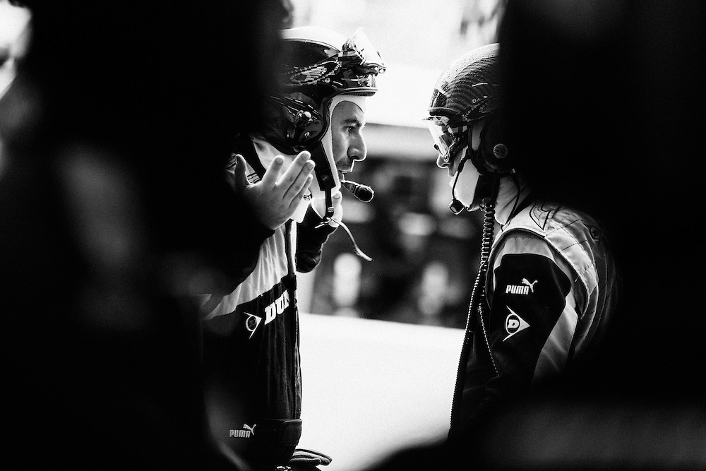 Two tyre specialists discuss options in the Nissan G-Drive OAK racing pits during the 2014 Le Mans 24 race. Le Mans, France, 14th June 2014. Photo by Greg Funnell.