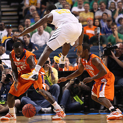 Mar 17, 2011; Tampa, FL, USA; West Virginia Mountaineers guard Darryl Bryant (25) is fouled by Clemson Tigers guard Andre Young (11) during the first half of the second round of the 2011 NCAA men's basketball tournament at the St. Pete Times Forum.  Mandatory Credit: Derick E. Hingle