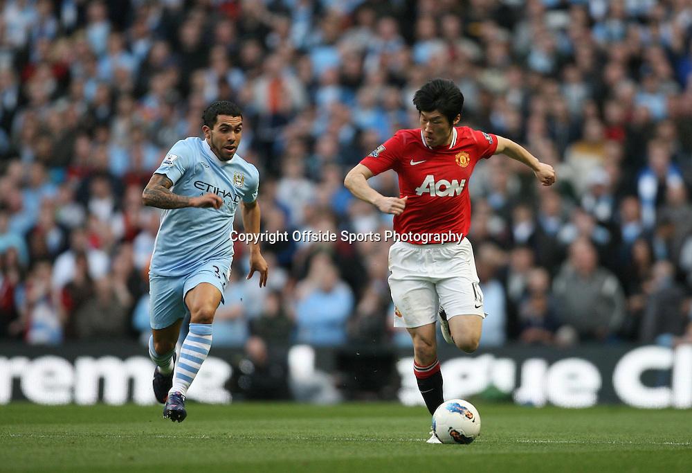 30/04/2012 - Barclays Premier League - Manchester City vs. Manchester United - Carlos Tevez of Man City battles with Ji-Sung Park of Man Utd - Photo: Simon Stacpoole / Offside.