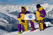 Australian mountaineers Greg Mortimer (left) and Luke Trihey hold Australian Geographic banner on Chongtar during first ascent 1994, Chinese Karakoram