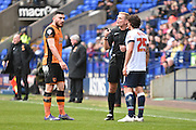Hull City Midfielder, Robert Snodgrass and Bolton Wanderers Defender, Lawrie Wilson clash during the Sky Bet Championship match between Bolton Wanderers and Hull City at the Macron Stadium, Bolton, England on 30 April 2016. Photo by Mark Pollitt.