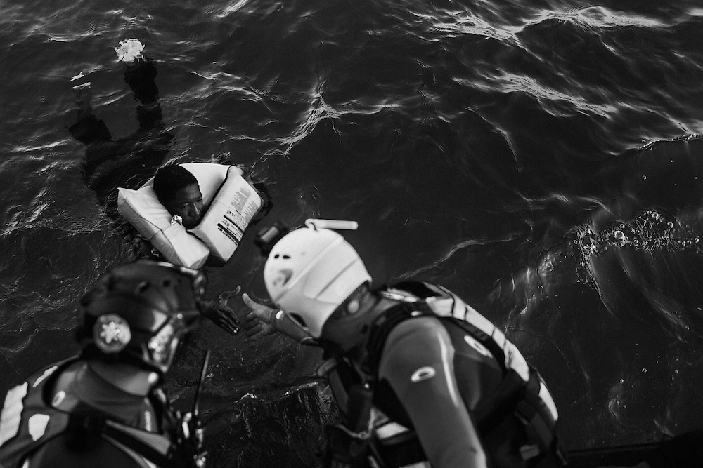 International waters off the Libyan coast. Aboard MOAS FRDC (FastRescueDaughterCraft).<br /> Paul, rescue swimmer, grabs the man's hand to get him on board.