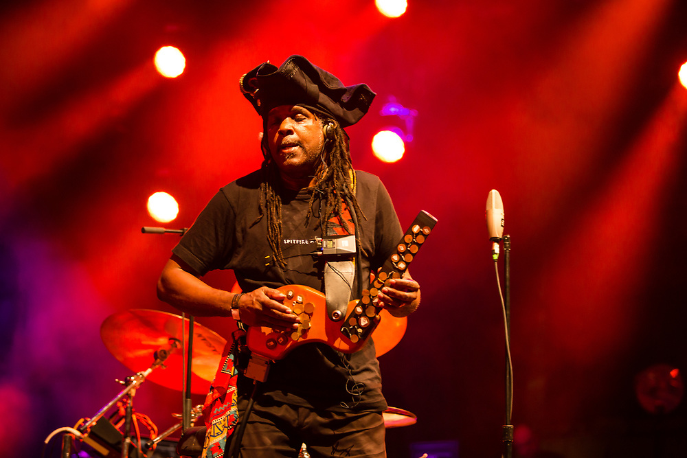 """3 August 2017 – Brooklyn, NY. Singer Nellie McKay opened for Béla Fleck and the Flecktones to a large crowd at the BRIC Celebrate Brooklyn! Festival at the Prospect Park Bandshell. The Flectones' percussionist Roy """"Future Man"""" Wooten playing a drumitar, a drum synthesizer, a keyed drum synthesizer shaped like a guitar."""