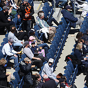 Fans watching game one during the New York Yankees V Chicago Cubs, double header game one at Yankee Stadium, The Bronx, New York. 16th April 2014. Photo Tim Clayton