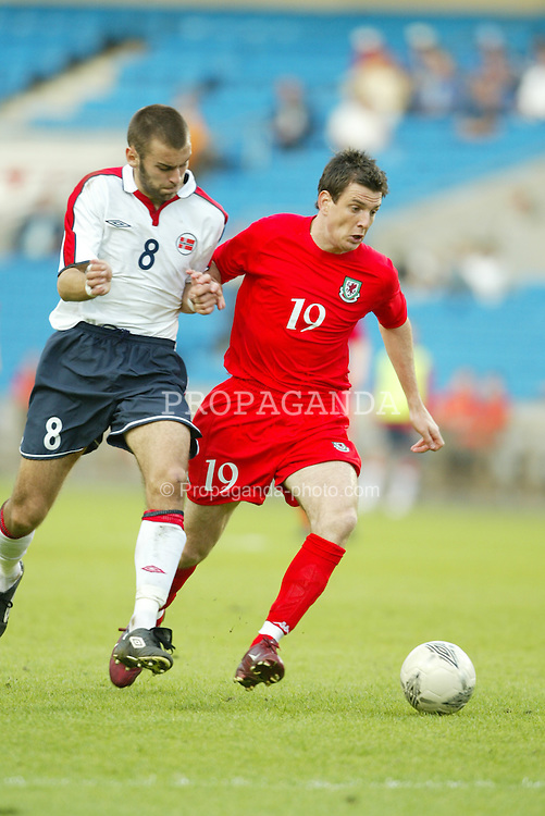 OSLO, NORWAY - Thursday, May 27, 2004:  Wales' Chris Llewelyn and Norway's Magne Hoset during the International Friendly match at the Ullevaal Stadium, Oslo, Norway. (Photo by David Rawcliffe/Propaganda)
