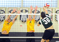 Central Bucks West's Adam Phillips #16 and Ryan Alu #2 defend as Pennridge's Josiah Friesen #36 spikes the ball during a volleyball match at Central Bucks West Monday May 2, 2016 in Doylestown, Pennsylvania.  (Photo by William Thomas Cain)