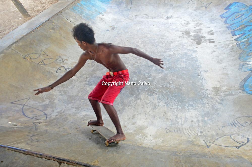 Young boys skateboarding in Midigama, Sri Lanka